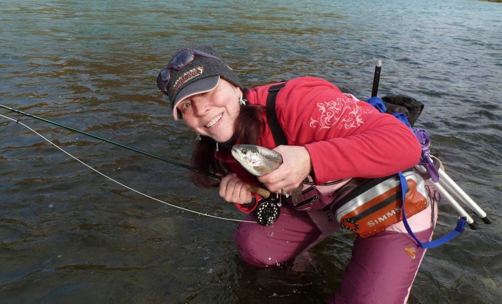 francesca-phw-alaska-participant-naps-her-first-rainbow-trout-of-the-day-near-the-confluance-of-the-kenai-and-russian-rivers