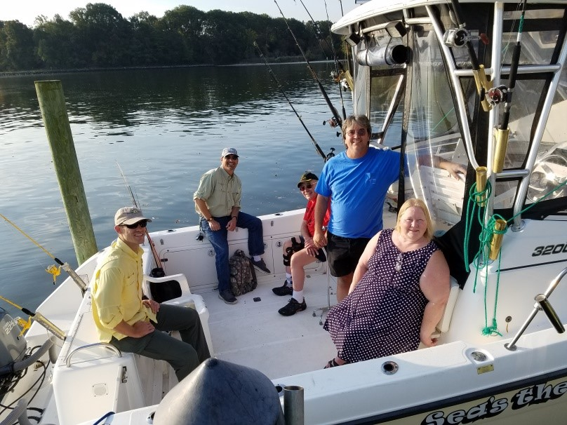 From left to right: Trevor Ibsen, Shawn Cushing, Bill Morris, Parran Wilkerson (boat captain), and Carol Morris relax before launching on their morning fishing adventure.
