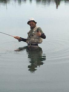 Jose Arana stalking fish in upper pond