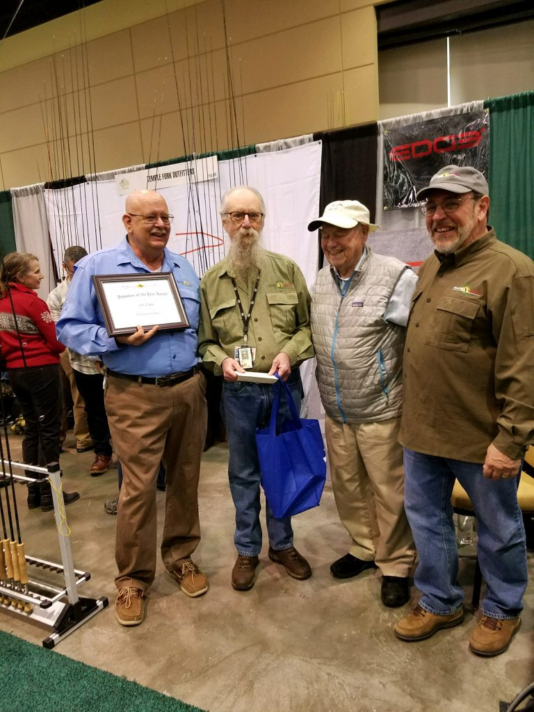 "Jim Clark being presented with the ""2016 Volunteer of the Year Award"" for the PA Region. Pictured are Skip Hughes, Jim Clark, Lefty Kreh, and Tom Herr"