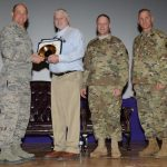 Damond is receiving the award from Col. Dietrich III, commander of the JBER/673 ABW.  The photo was taken by Airman 1st Class Christopher R. Morales