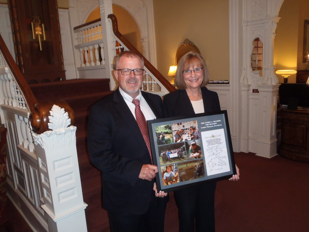 Jon Wilson (L) and Cathie Thomas (R) of the James A. Meador Foundation right.