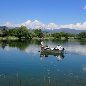 men fishing in a boat