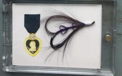 Disabled veteran ties 1,000 Purple Heart flies to honor combat wounded veterans